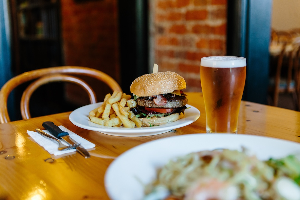 Hamburger, chips and beer at The Friendly Inn Bistro
