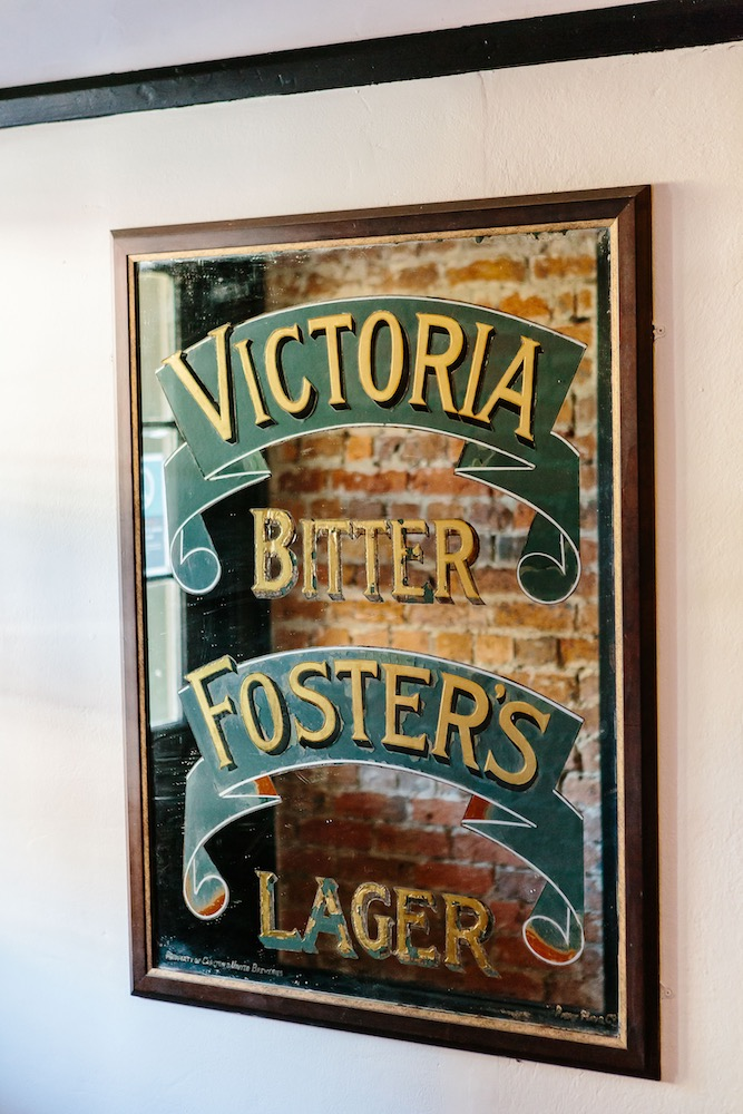 Victoria Bitter Foster's Lager Sign at The Friendly Inn Bar